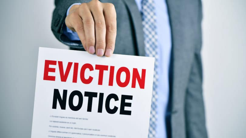 Eviction Notice Man Holding Sign