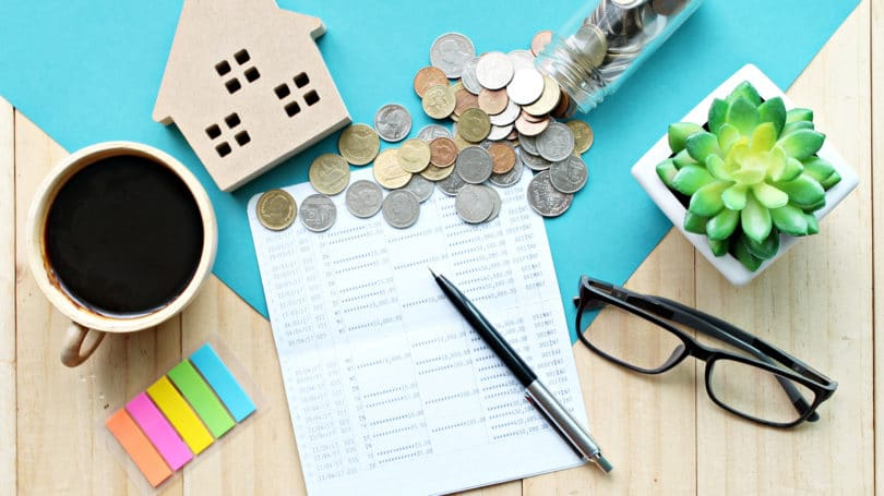 House Logging Financial Planning Budget Rent Passive Income Counting Coins