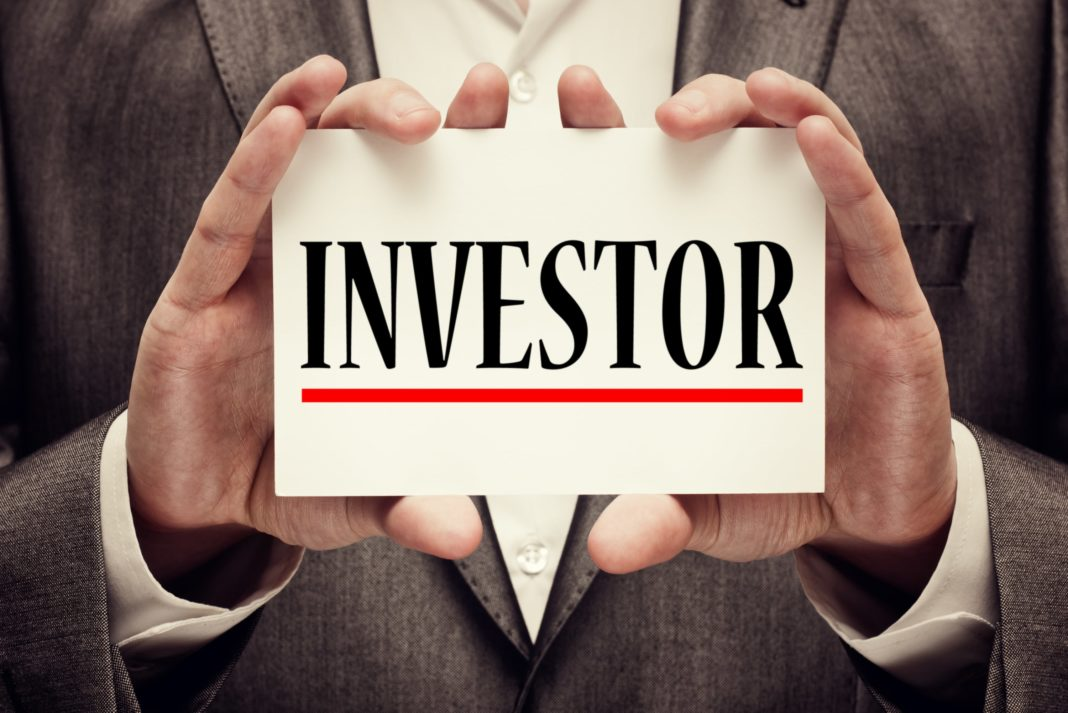 Investor Holding Card Suit Words