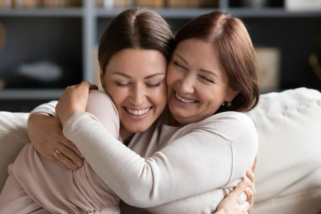 Mother Daughter Middle Aged Adult Child Hugging Smiling
