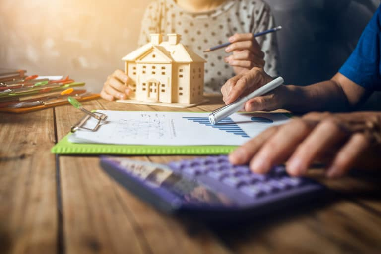 Woman Calculating Home Mortgage Tax Financial Purchase Finance Real Estate