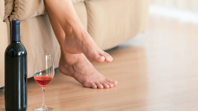 Bottle Of Wine Rose Red Woman Relaxing At Home Sofa Barefoot