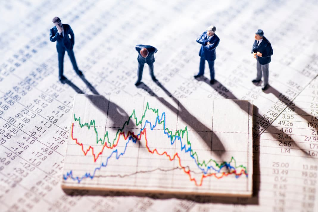 Businessmen Analyzing Stock Market Charts