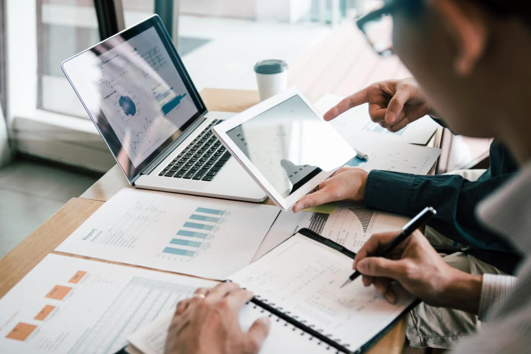 Financial Advisor Business Partner Two Men Discussing Finances Charts Analytics