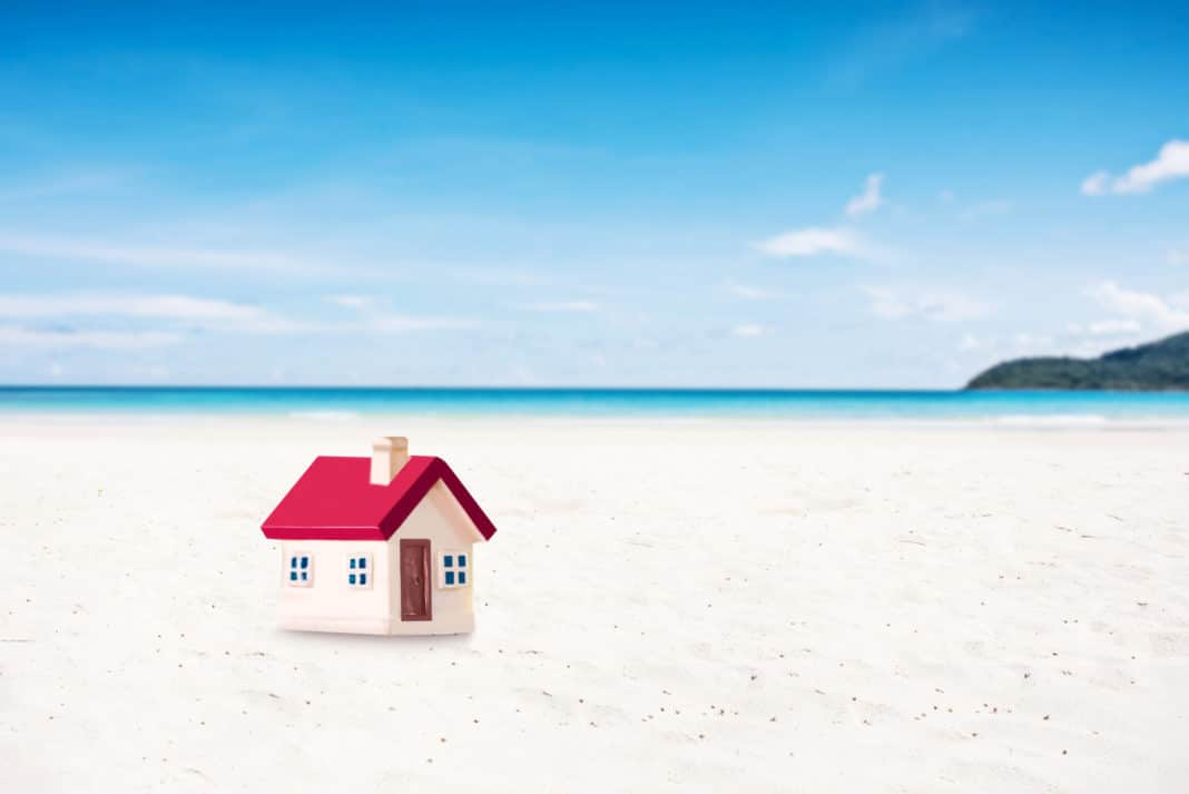 House Miniature On Beach White Sand Ocean