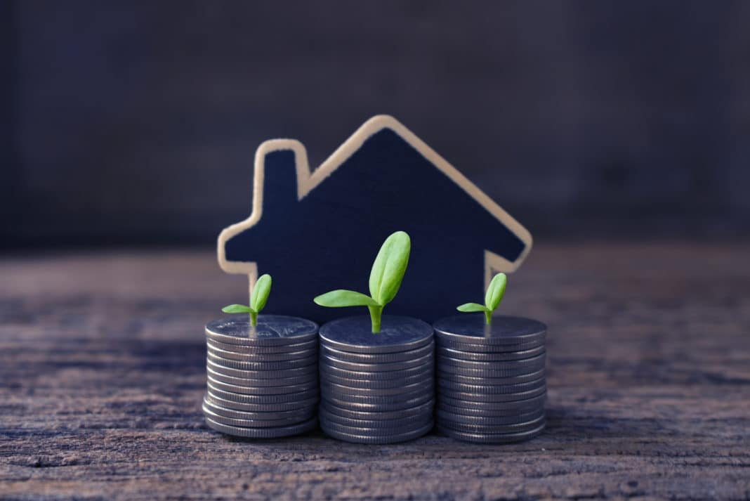Investing In Real Estate Stacked Coins Model