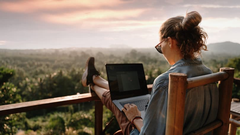 Woman Working Remotely From Mountains Country Cabin