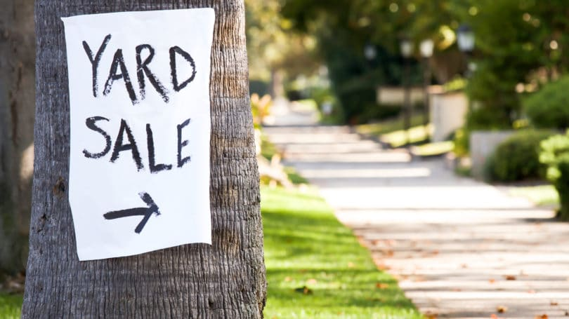 Yard Sale Paper Sign On Tree
