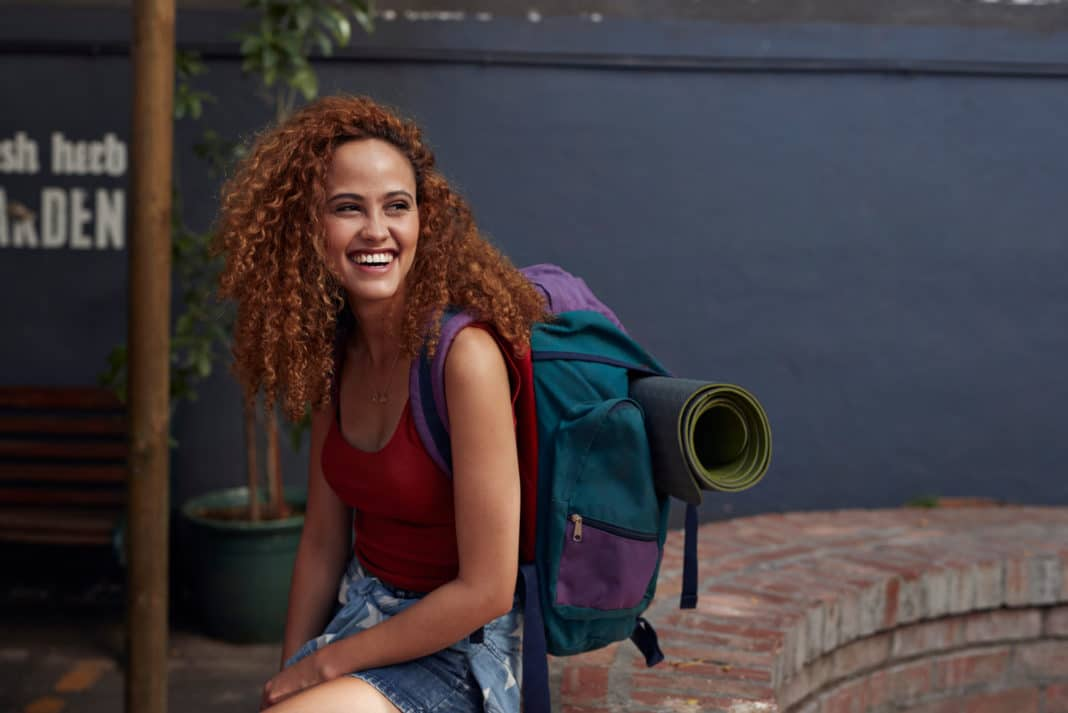 Young Woman Sitting Backpack Yoga Mat