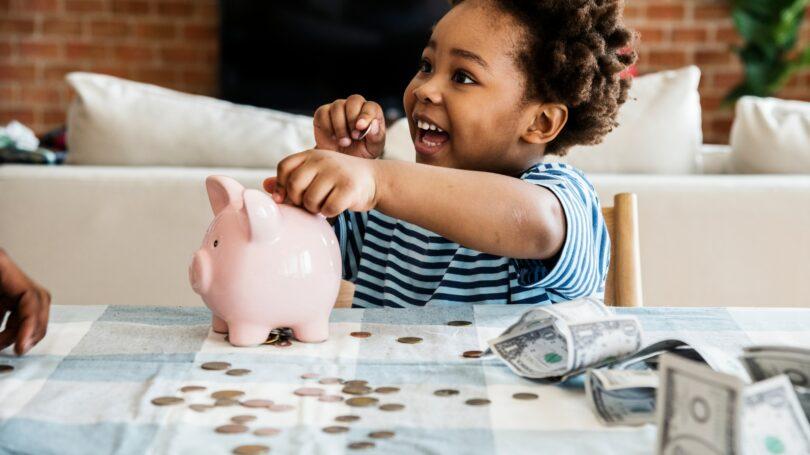 Black Boy Collecting Money Piggy Bank Saving Coins Cash