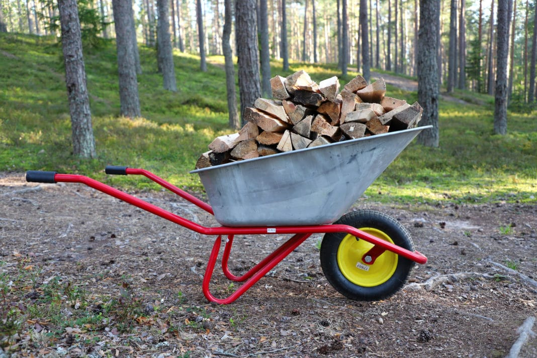 Wheelbarrow Pile Of Wood Metal Outside Forest