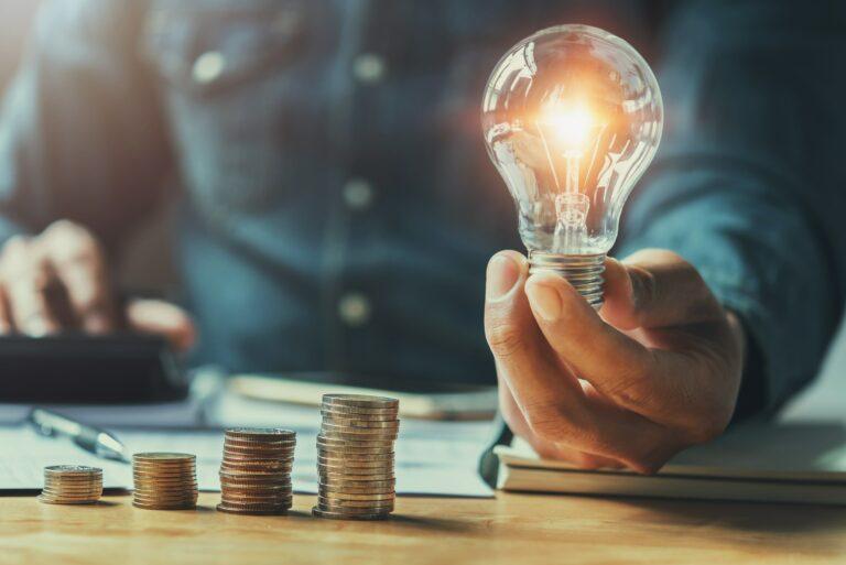 Light Bulb Coins Stacked Saving Money Concept Idea
