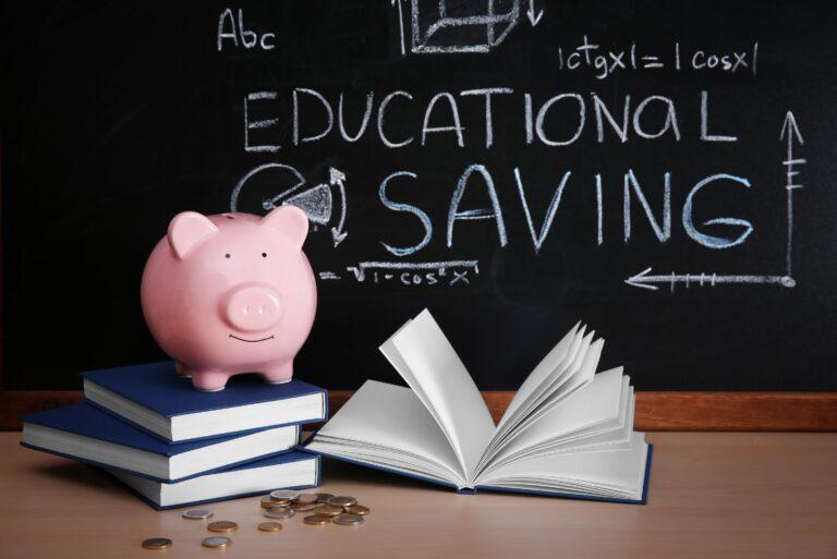 Piggy Bank Books Coins On Blackboard
