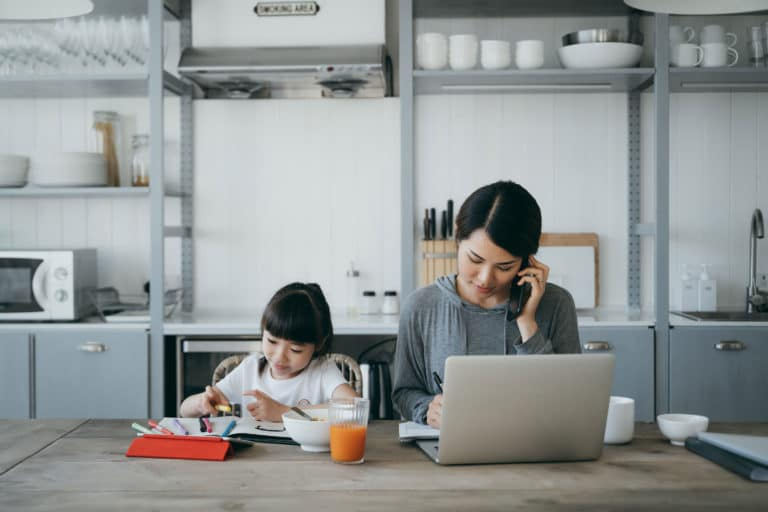 Woman Working From Home Child
