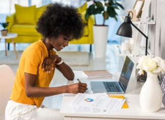Woman Working From Home Yellow Shirt