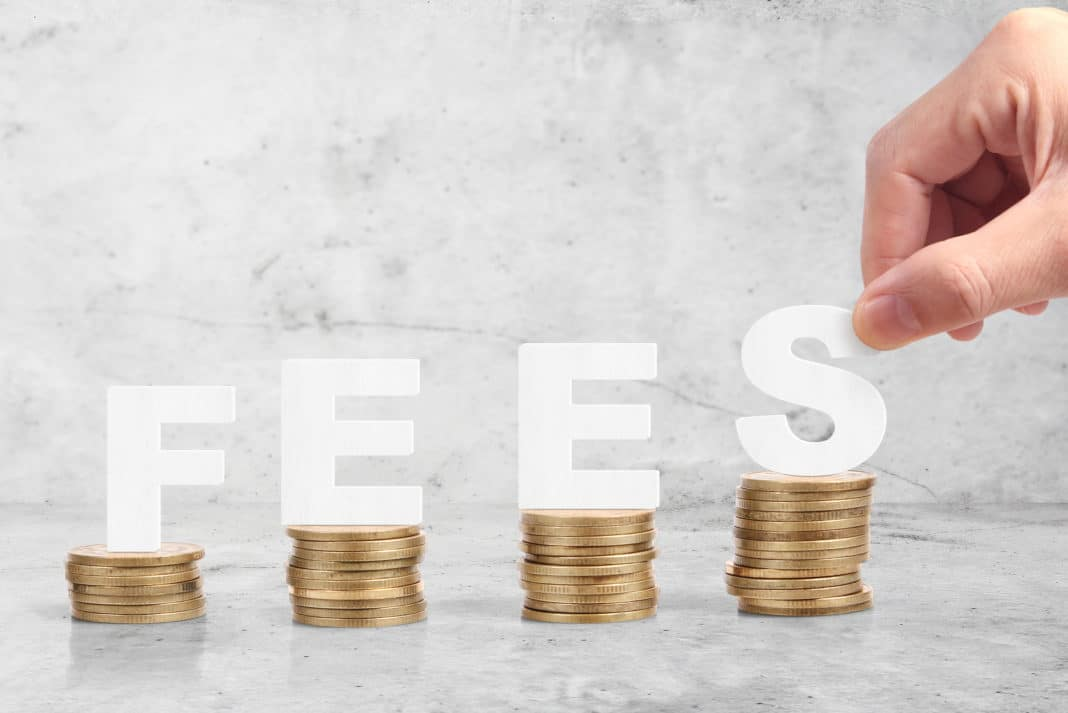 Fees Stacked Coins Wooden Letters