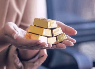 Hands Holding Gold Bullion Bars