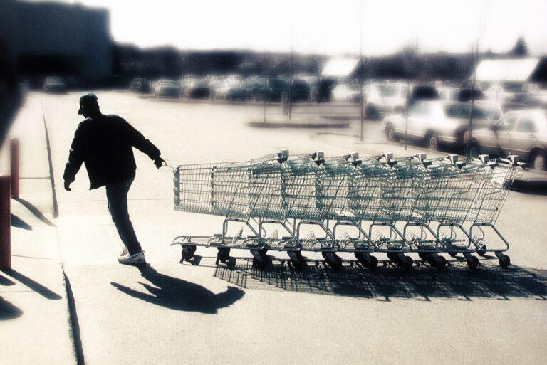 Man Collecting Shopping Carts Parking Lots