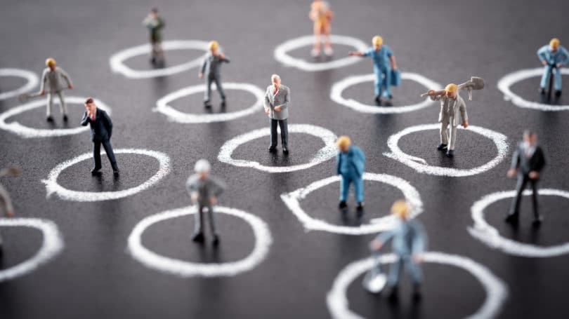 Miniature People Standing In Circle Social Distance