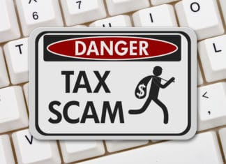 Tax Scam Danger Keyboard Sign