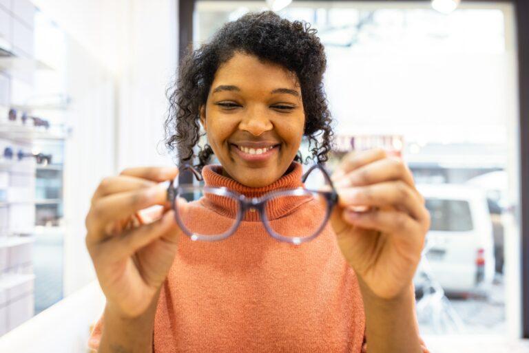 Female Customer Holding Pair Glasses