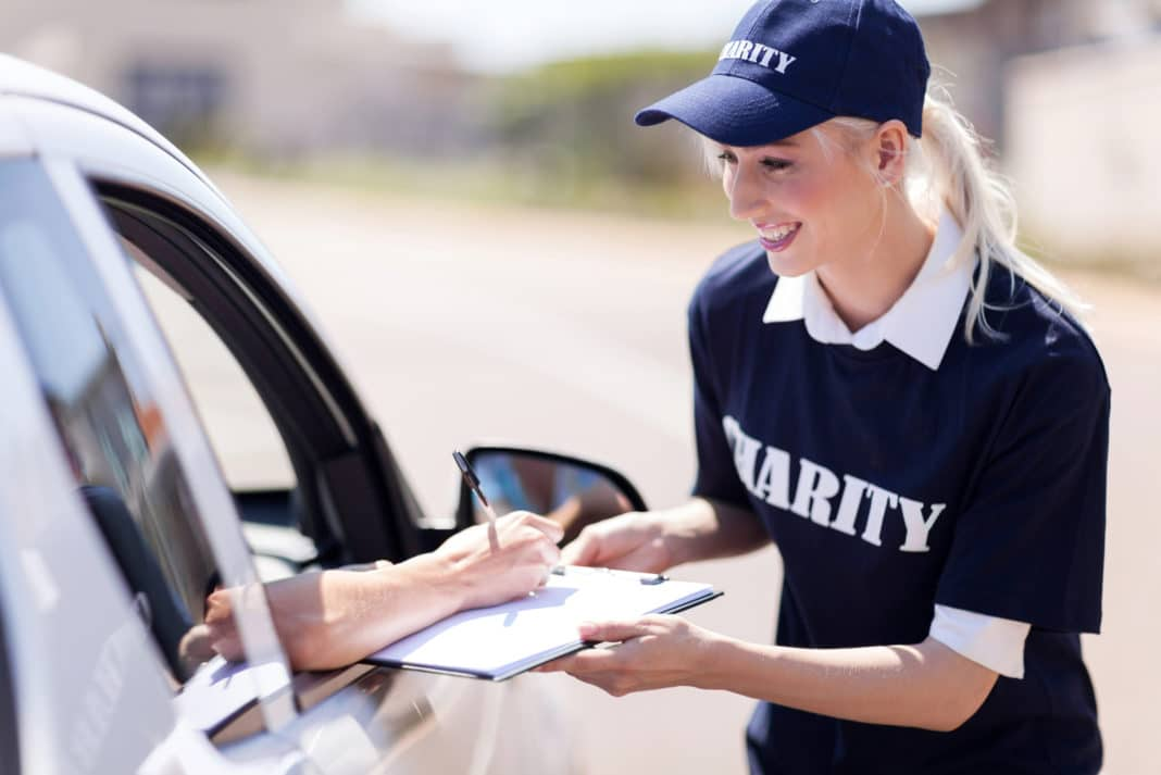 Car Passenger Signing Charity Form