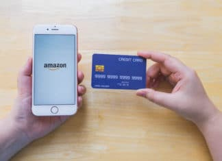 Hands Holding Iphone Displaying Amazon Credit Card