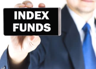 Man Holding Mobile Phone Displaying Index Funds