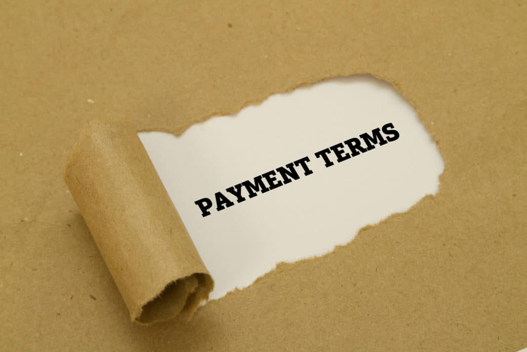 Payment Terms Text Under Torn Paper