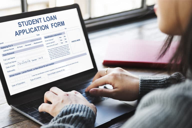 Student Completing Loan Application Form