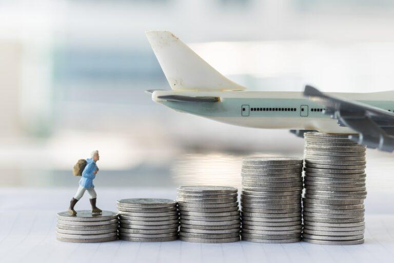 Figurine Hiker Climbing Stack Quarters Airplane