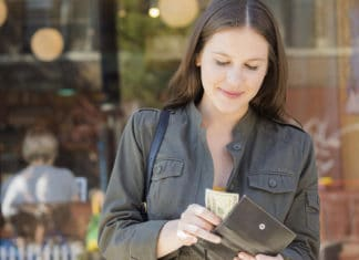 Caucasian Woman Counting Money In Wallet