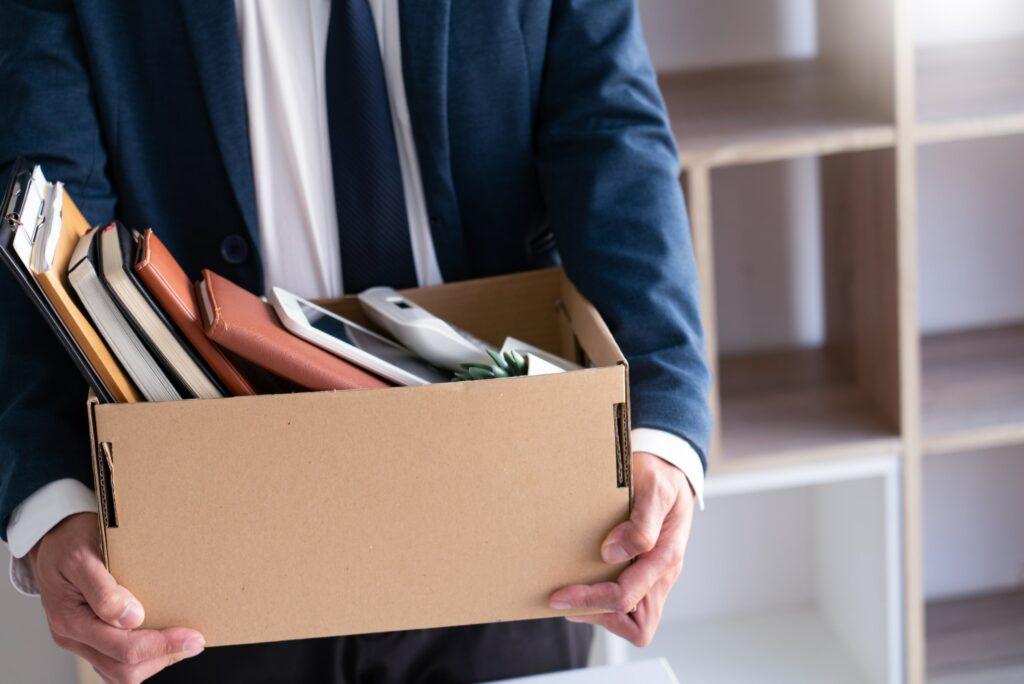 Businessman Carrying Cardboard Box