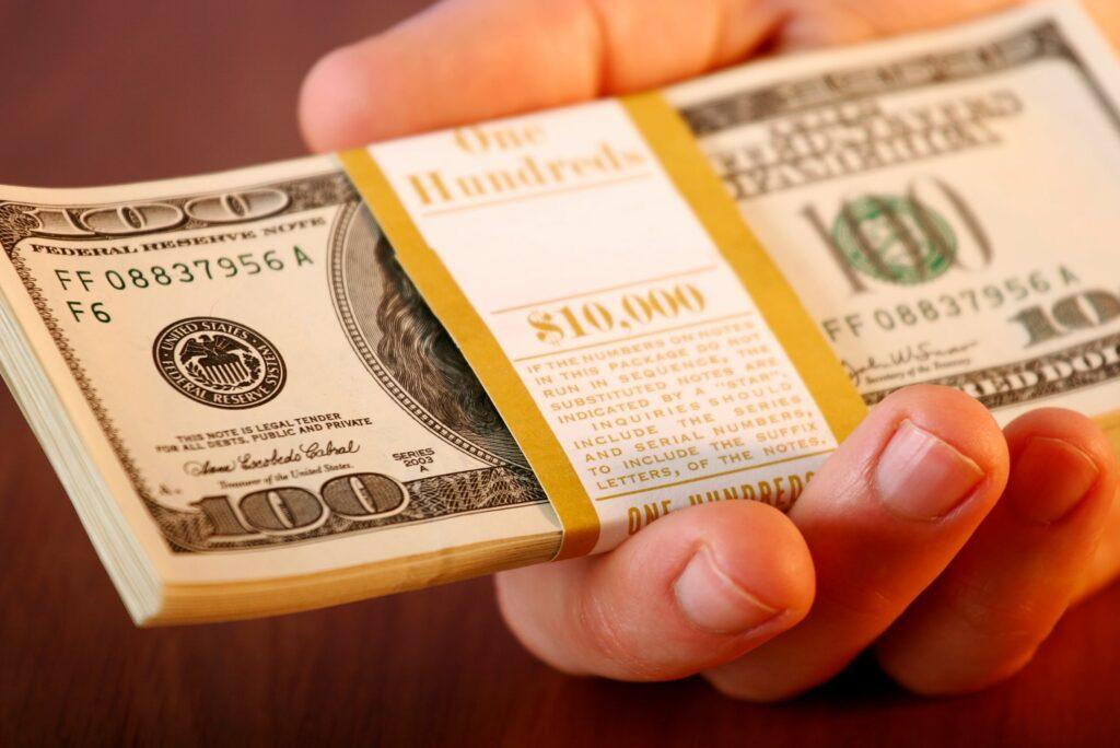 Hand Holding 10000 Dollars Cash