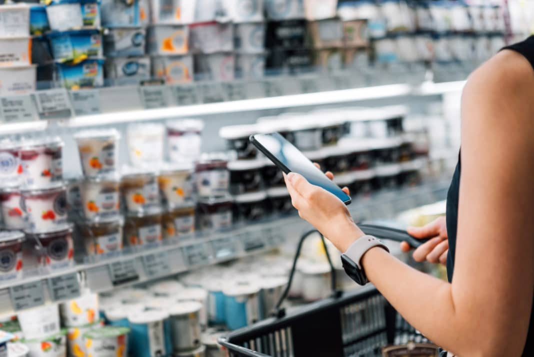Woman Holding Shopping Basket Smartphone Grocery Store