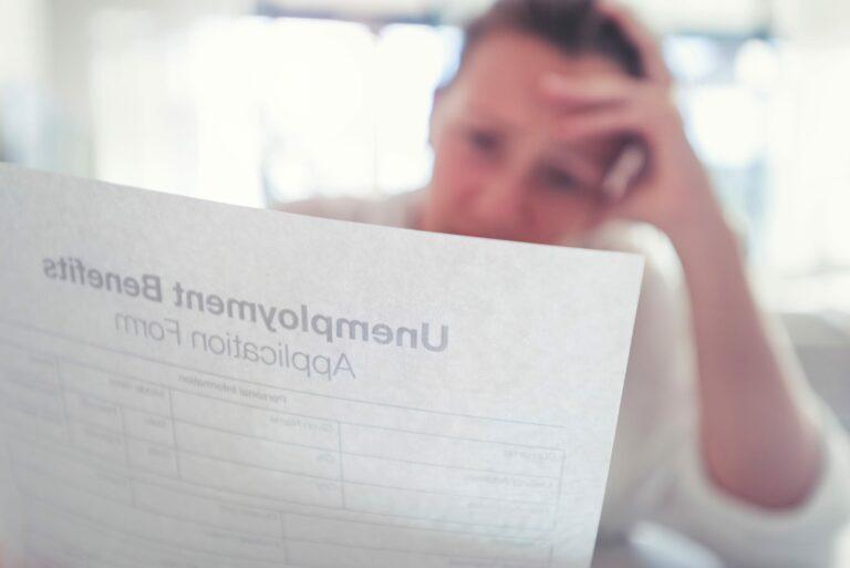 Woman Holding Unemployment Benefits Application Form