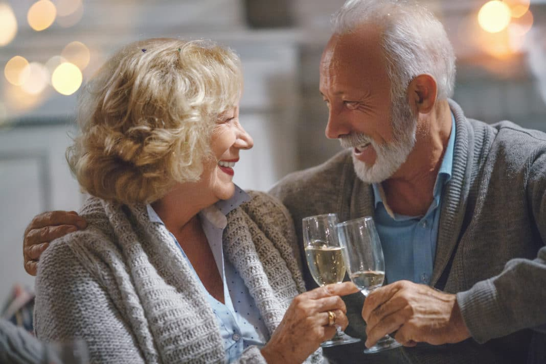 Old Couple Toasting Champagne