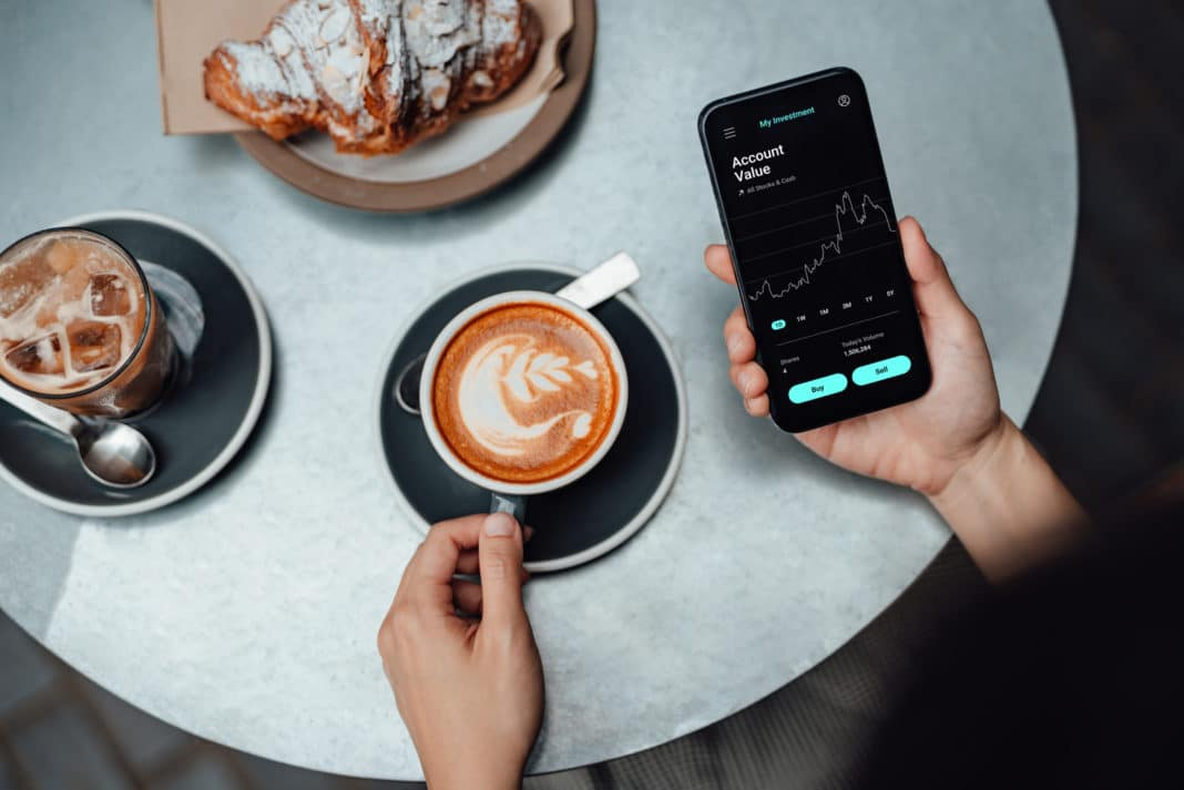 Woman Smartphone Trading App Coffee Croissant