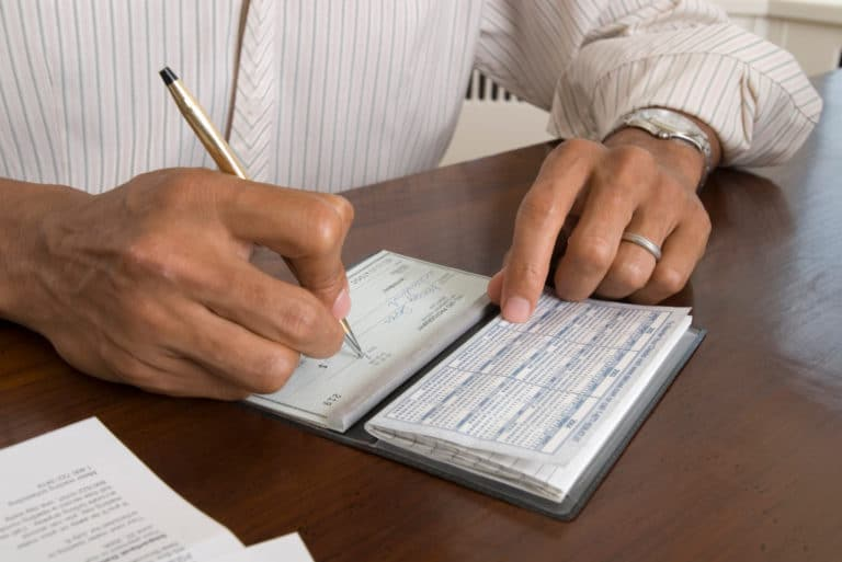Man Writing Check Pen Desk