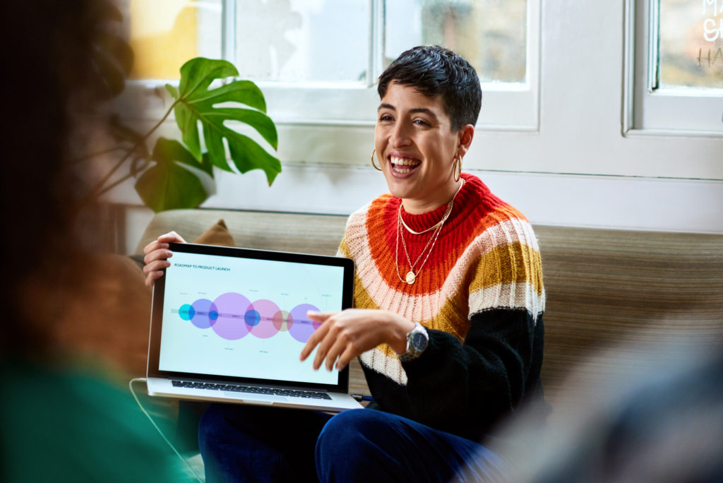 Woman Holding Computer Sitting Couch